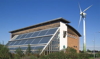 A view of the Ecotech Centre building and turbine
